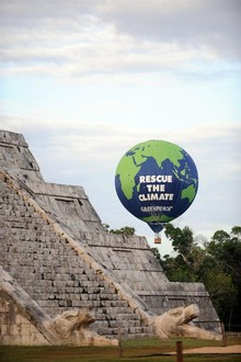 Greenpeace flies a hot air balloon with environmental messages over the ruins of the ancient Mayan city of Chichen Itza